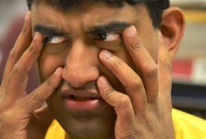 Tejus Sharathchandra, 20, reacts as he folds letters at the Vocational Training Center of Western Psychiatric Institute and Clinic of UPMC on the South Side.